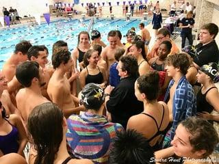 Swim team with coach