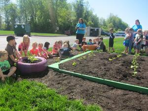 Kids gardening outside